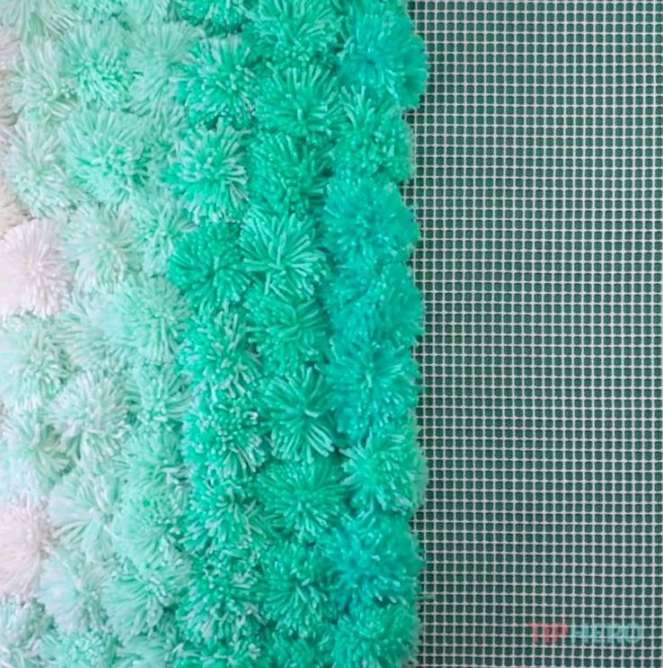 Sink your toes into a cushy pom-pom rug--it's easy to make by hand, and a great way to use up leftover yarn. Check out our step-by-step instructions and video.