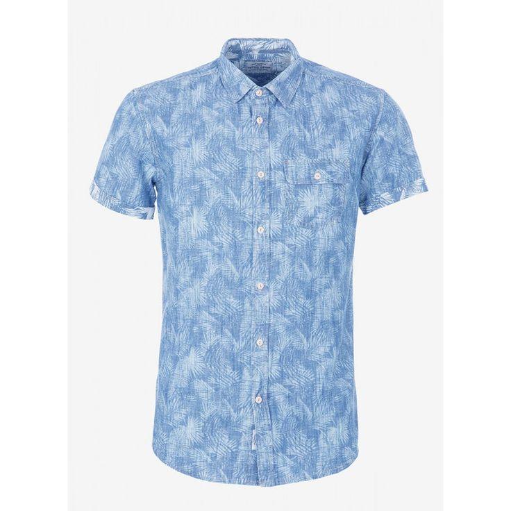 Camisa de manga corta , bolsillo lateral y dobladillo en mangas . Modelo de la marca Tiffosi con estampación de palmeras y 100% algodón. Modelo fresco y juvenil .