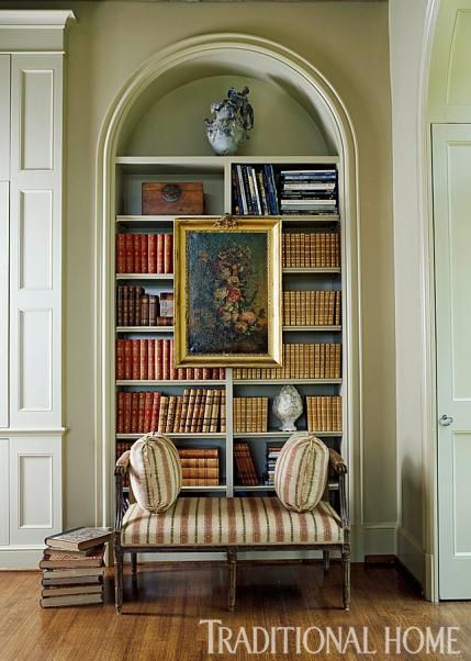 Books And Artwork Decorate The Shelves Of This Elegant Arch And Make A  Lovely Vignette.