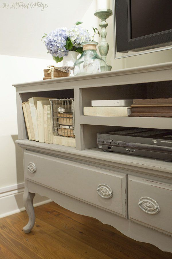 Credenza Makeover - doors and drawers were removed and the credenza and hardware were painted with Annie Sloan's Chalk Paint, in French Linen - and now it's used as a TV stand - via The Lettered Cottage