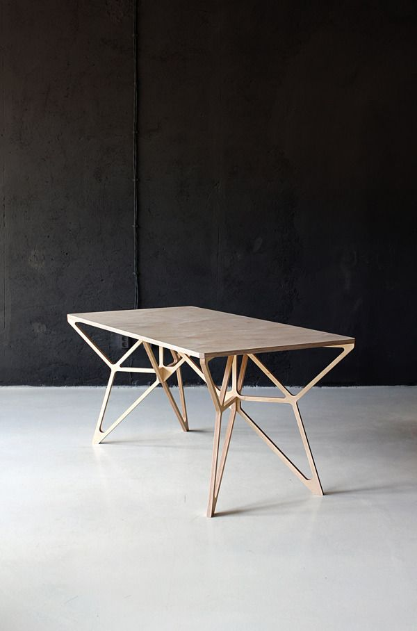 This modern table uses angular shapes and lines to give it personality and make it appears it doesn't take up much room.