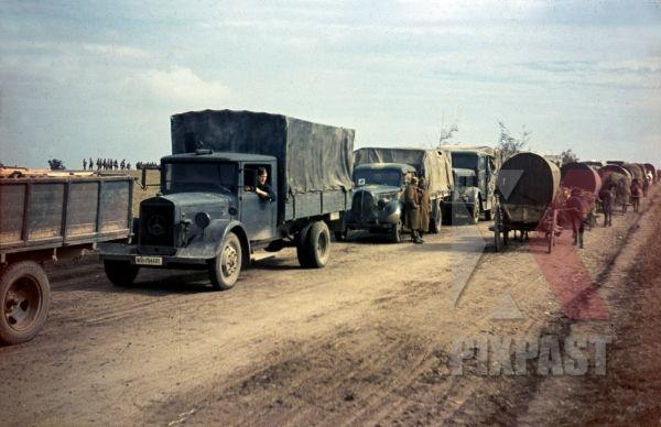 German army supply trucks retreat beside Romanian infantry unit, Russian Front 1944