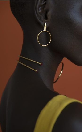 Experimenting beyond her signature coiled snakes, the Colombian designer's new collection is an array of geometric pieces rendered in her trademark vibrant gold-plated brass.  Accents of onyx, turquoise and Swarovski crystal pop against the richly colored metal.