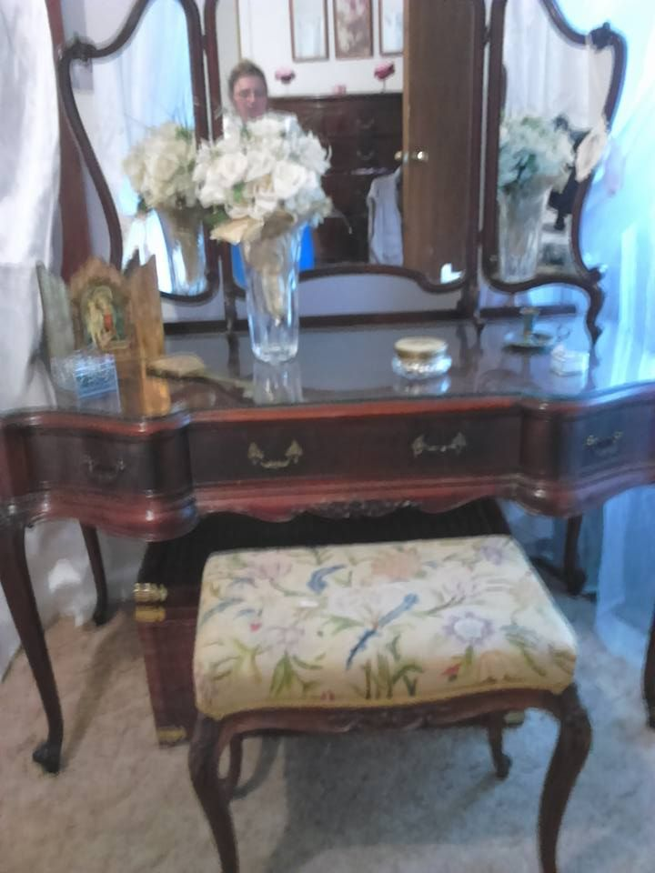 This is in the far corner of the room and is my grandmothers dressing table, opposite in the reflection you can see the matching tall boy. It is genuine and is divine craftsmanship.  The detail in the scroll work is beautiful. I didn't have the matching stool given to me   for some unknown reason and I found an almost identical match with a beautiful tapestry and  identical scroll features and legs with  the same carvings. My  son and his girlfriend got it on ebay for me for  $70 AUD