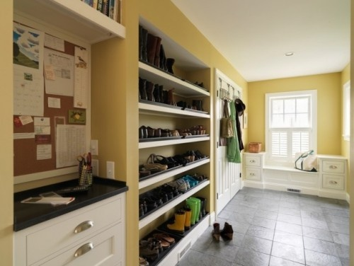 mudroom ideas : shelves for shoes, message center on the left, built-in seats below the window, over-the door hooks, laundry area behind the double door, rugged tiles for heavy-duty floor