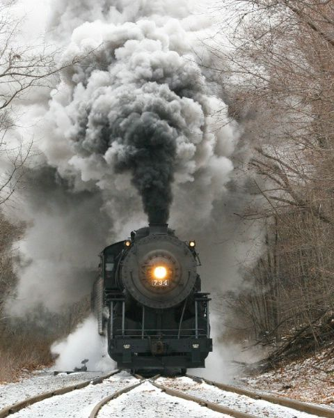 Beautiful shot of a steam engine in the snow