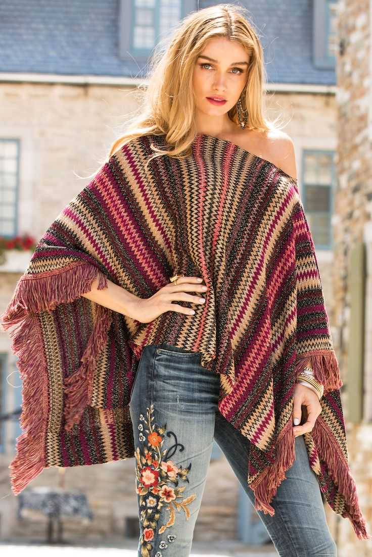Distinctive patterns in bold color accent this easy chevron fringe poncho with shimmering detail and fringe hem. Pair with embroidered denim.