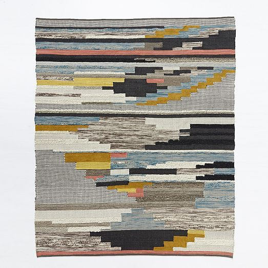 NEW! Inspired by a 1970s wall hanging, our Multi Pixel Rug is handwoven by Craftmark-certified artisans in India using yarns of varied texture and color. The facility where it's made is Fair Trade Certified™ and the artisans have chosen to use the premium they earn from Fair Trade production to fund additional healthcare coverage.