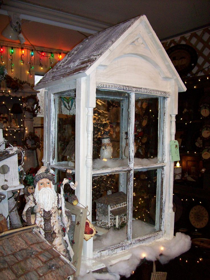 old  windows recycled into a fun display.... old tin on the roof...