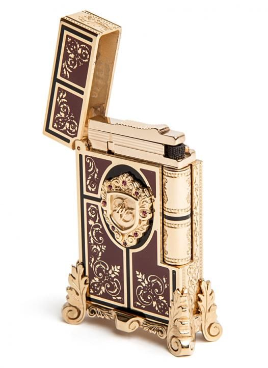 The product is finely engraved, evoking the delicate floral marquetry patterns characteristic of the 1872 period. The lighter is decorated with a beautiful hand-sculpted bronze piece, inspired by Second Empire furniture legs.    The central medallion, also hand-sculpted, is adorned with the D signature as a tribute to Lucien and Andre Tissot Dupont who created the brand in 1872. #SecondEmpire #STDupont Available at LightersDirect.com