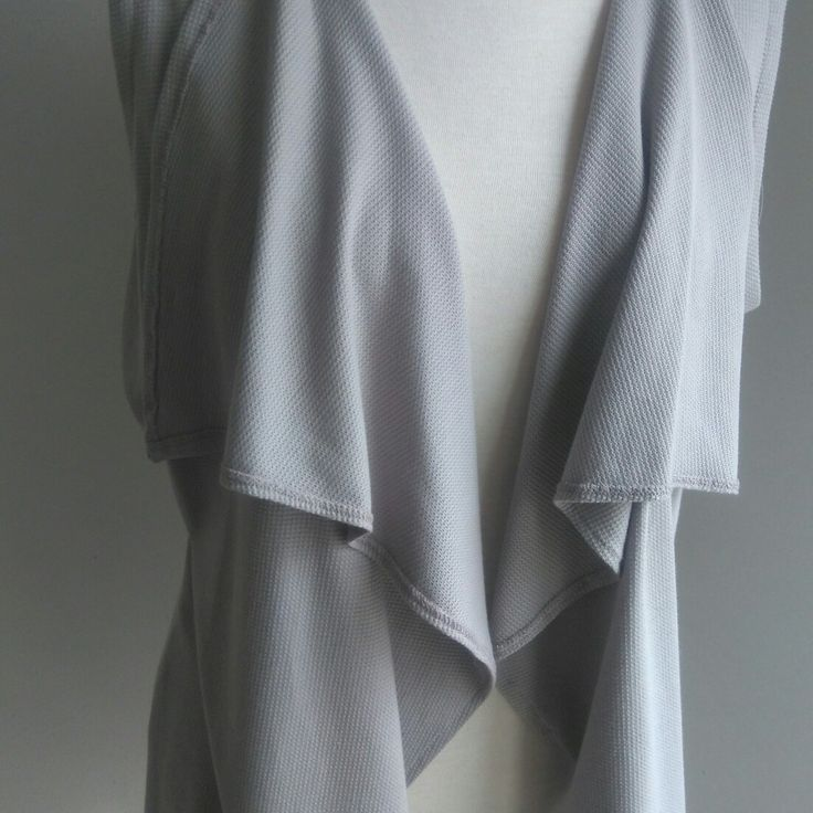 Sleeveless grey Waterfall top  Follow us on Fb and instagram  nouf clothing