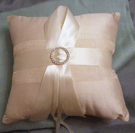 Ring cushion - I made this for my friend Margaret when she was getting married. It ensured the safe arrival of her rings to the altar, delivered cautiously by her super cute pageboy.