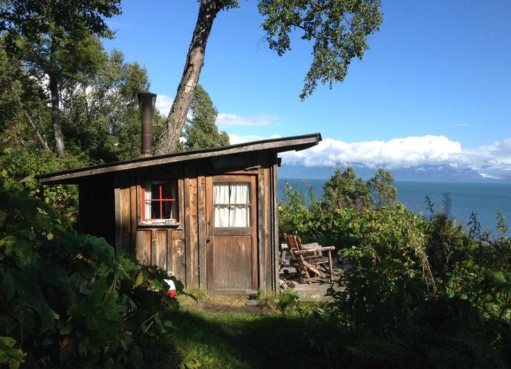 The Seashell Cabin is just one of several cabins that can be rented on the Kilcher homestead near Homer, Alaska. The tiny cabin has views of Kachemak Bay.