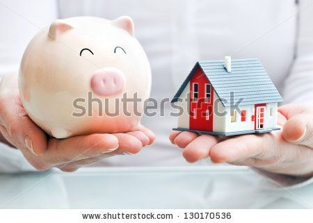 Ideal Hands holding a piggy bank and a house model Housing industry mortgage plan and residential