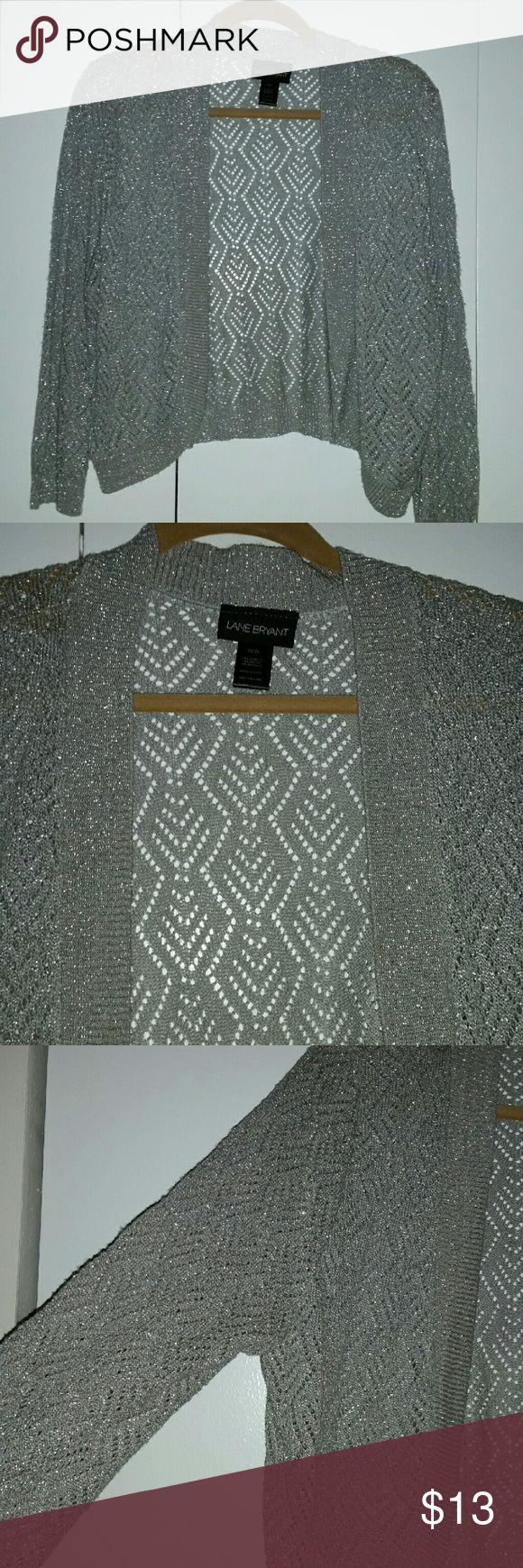 Lane Bryant grey/silver plus size shrug sweater Grey shrug sweater with silver mettalic threading. Great for the holidays! Lane Bryant Sweaters Shrugs & Ponchos