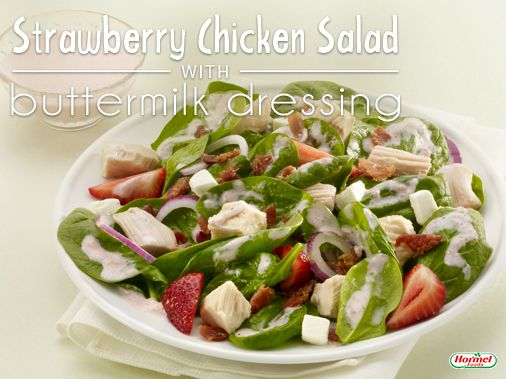 A fresh strawberry chicken salad with spinach leaves, HORMEL® Real Crumbled Bacon, sliced onion, cubed cream cheese, and a simple homemade buttermilk dressing! #salad #recipe #spinach #healthy