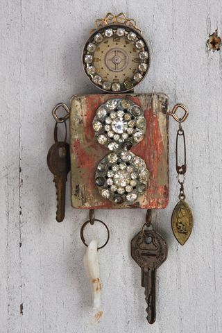 Wooden Doll With Found Objects For Limbs Then Sparkled With Jewelry