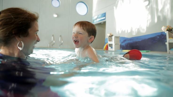 Having fun at swim lessons | Swim lessons, Swim school ...