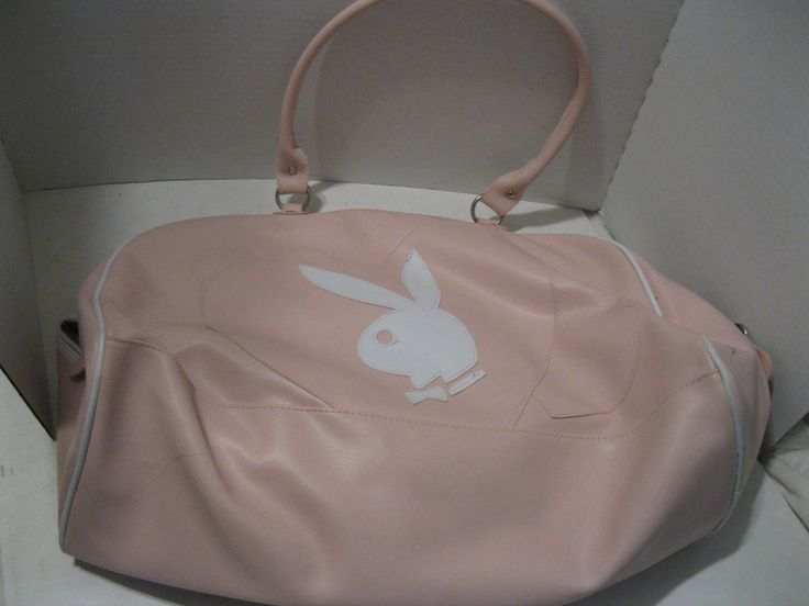 "Multi-purpose bag -- pink vinyl Playboy bag. White Playboy bunny of front of bag. Could be used as a tote bag, a large purse or a small suitcase. 18"" wide at base, 11"" tall, base is 7 1/2"". Straps have 11"" drop. 