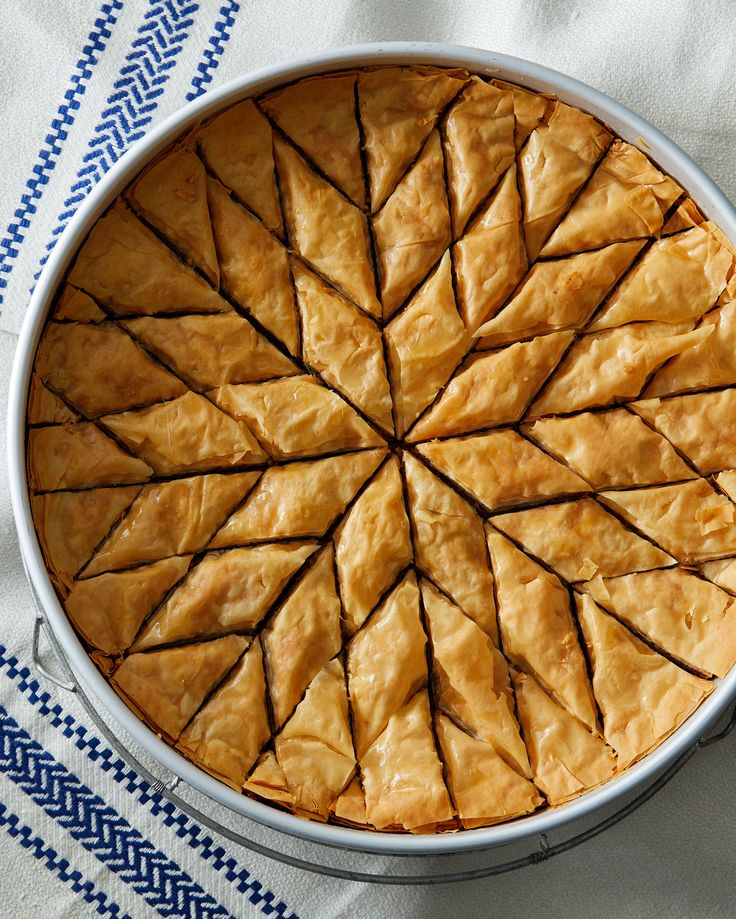 Walnut-and-Honey Baklava | Martha Stewart - The many buttered layers of phyllo dough, walnut filling, and sweet syrup make baklava the ultimate special-occasion dessert in Greece. #baklava #honeyrecipe #phyllodough #walnutrecipe