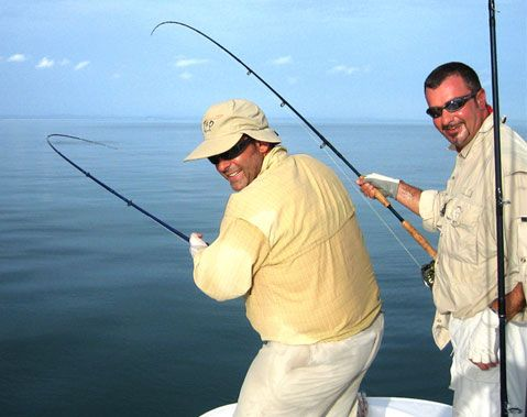 Andrea Pellegrini and friend with the Revo Salt on Tarpon off the coast of Cuba.