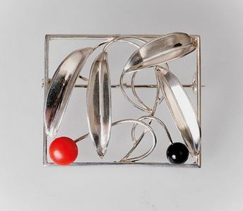 Friedrich Luttenberger (in the style of). Silver, coral, and black enamel brooch, c. 1925, Vienna. 3.2 x 3.8 cm.  Marked: 900, AWR.