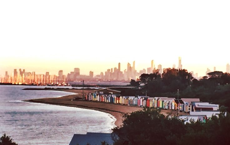 early morning cycle , view of city and beach huts