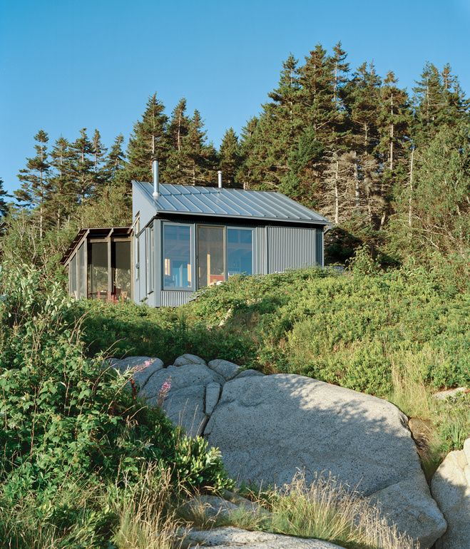 Alex devised a system that takes advantage of ocean views while protecting the cottage from that same northeasterly orientation. The large windows and doors can be shuttered with corrugated aluminum panels.  Photo by Eirik Johnson.