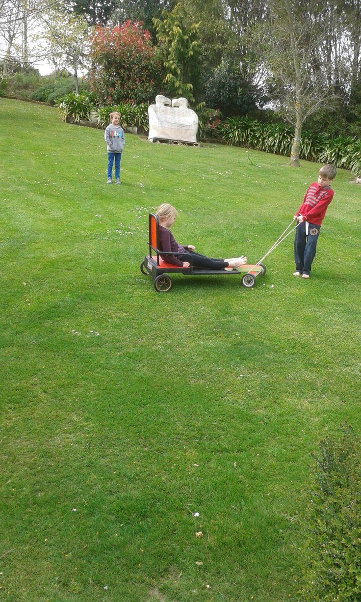 Grandchildren playing on the hill in Nana's garden.