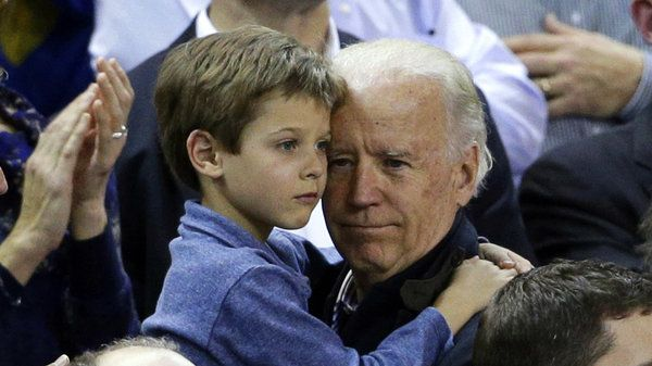 Vice President Joe Biden holds Beau Biden's son Hunter during a basketball game in 2013.