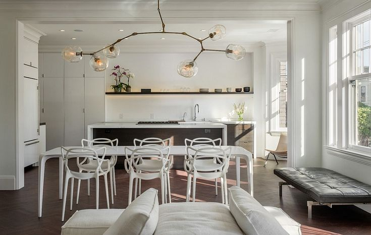 Fascinating Masters Chairs and lighting bring uniqueness to the trendy dining room [Design: Sutro Architects]