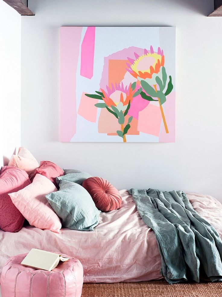 Complement colorful artwork with accent pieces or bedding for some relaxing vibes.