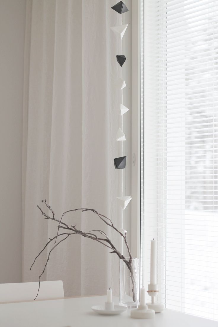 Window decoration made of folded paper triangles.
