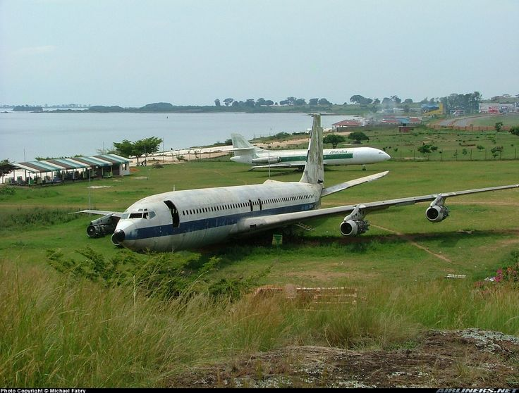 I just had to clear many armed guards to get to this position. Found on the side of EBB airport. Former Alitalia Caravelle (ex I-DABA) in the background. The 707 is ex British Airtours G-APFL. - Photo taken at Entebbe - International (EBB / HUEN) in Uganda on December 13, 2004.