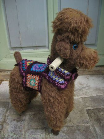"""Poodle """"rocking horse""""... riding animal - with crocheted granny vest."""