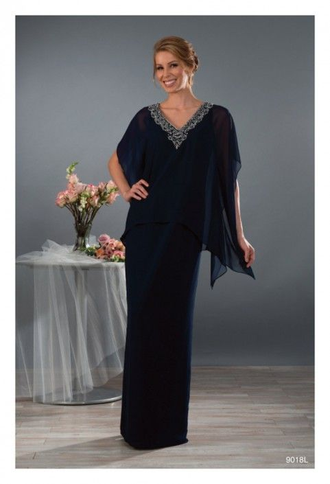 Style 9018L from Alfred Angelo is a long, chiffon column gown with embroidered and crystal beaded V-shaped neckline and kaftan overlay.