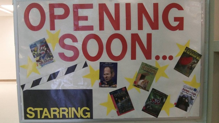 Modified another board for the start of school to 'announce' some of our new books.   Library bulletin board.