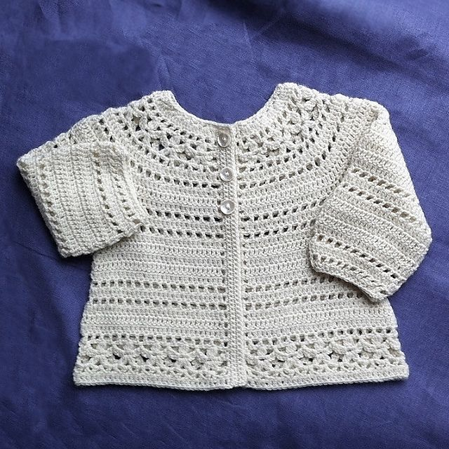 Ravelry: Gina - floral lace baby/child cardigan pattern by Vicky Chan - malabrigo sock, natural color way.