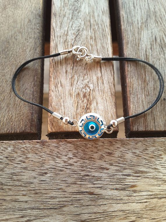 Check out this item in my Etsy shop https://www.etsy.com/listing/116753682/glass-evil-eye-silver-bracelet