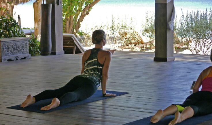 Getting into cobra facing the Caribbean Sea at Laluna's beachfront yoga pavilion