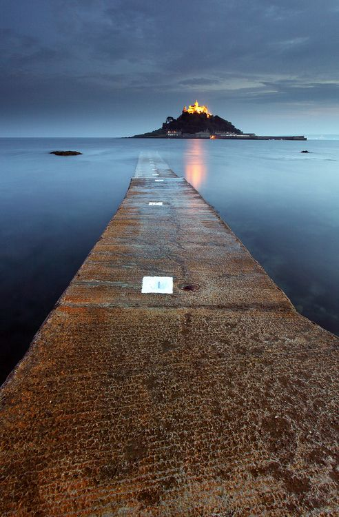 After Dark, St. Michael's Mount, Cornwall, England.  This is the coolest place. You take a boat out and when the tide goes out you can walk back on this road.