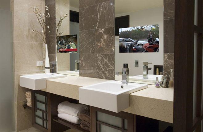 Mirror tv in the bathroom. #mirrortv #hiddentv #glasstv