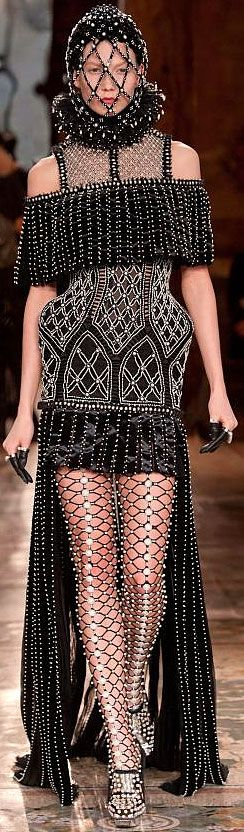 #Alexander McQueen F/W 2013-2014 RTW Paris FW ... this is a bit much for me, but I do like the piece over the top of the arms.