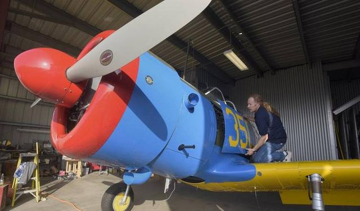 """Jason Reid removes panel to display inner workings on his 1942 Vultee BT-13A trainer at Modesto Airport.A U.S. Army trainer from World War II, close to going airborne for the first time in 70 years, will make that """"maiden voyage"""" from Modesto Airport.  The Vultee BT-13 Valiant was in pieces, spread between three hangars at the airport, when Jason Reid purchased it from the Commemorative Air Force.When he's done, it will be among an elite group of fewer than 50 airworthy BT-13s in existence."""