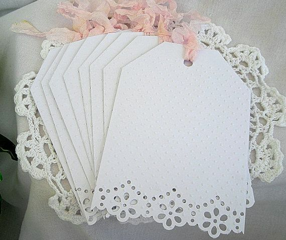 handmade shabby-chic doily lace cards, these would be cute on Christmas packages..read paper, white tags.