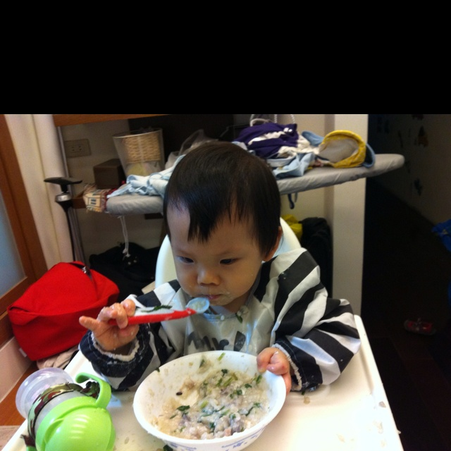 Learning eating on his own