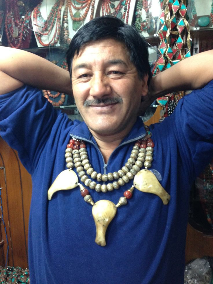 Our friend Nizam who creates Tibetan beaded necklaces from antique beads.