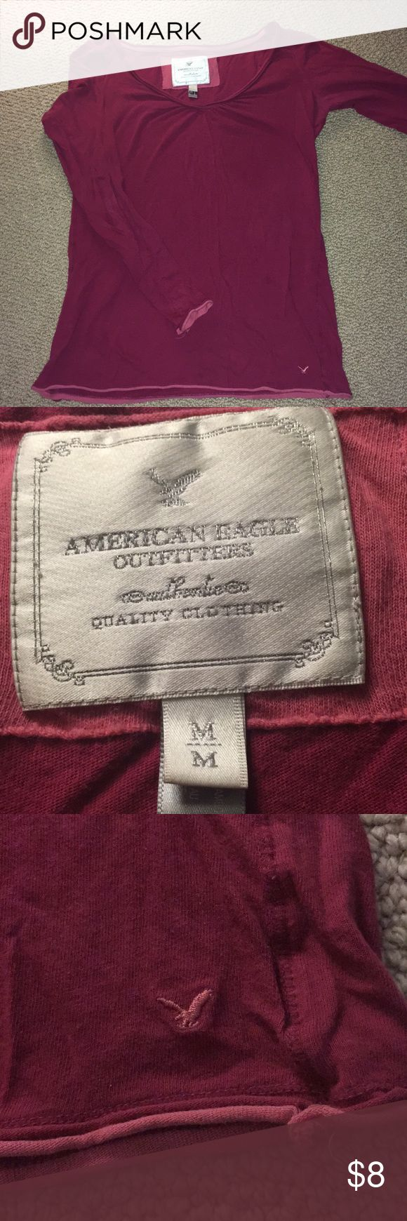 American Eagle Outfitters cranberry long sleeve t Cranberry colored American Eagle Outfitters long sleeve t. Bottom of shirt and sleeves are accented with a light pink material and the neckline is a slight v-neck. American Eagle Outfitters Tops Tees - Long Sleeve