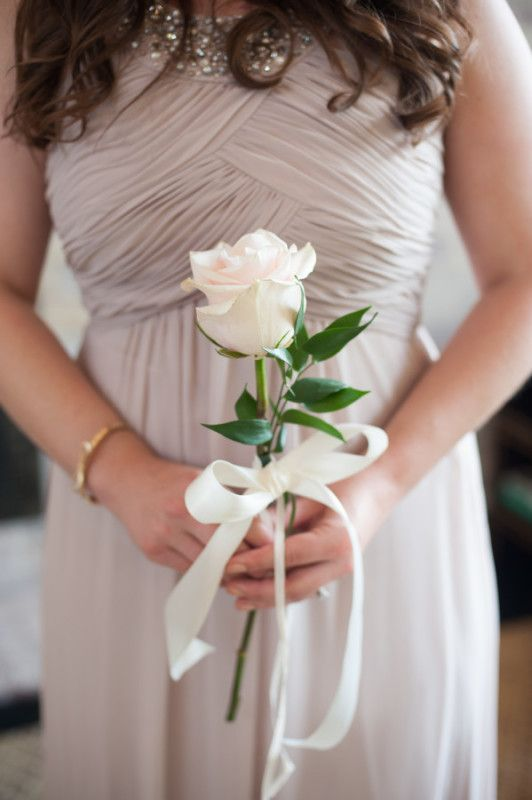 A Gorgeous Farm Wedding on StyleBlueprint.com! The bridesmaids each carried a single, beautiful rose.