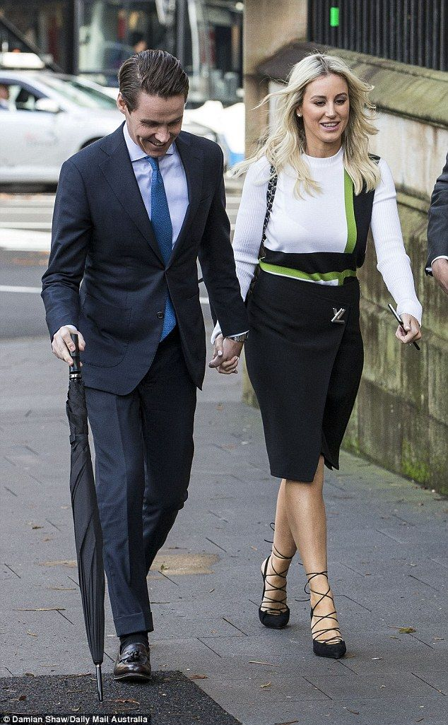 Everything is all-white, dear: Roxy Jacenko and husband Oliver Curtis looked at ease on Wednesday as they arrived at the New South Wales Supreme Court in Sydney ahead of the businessman's final day in court